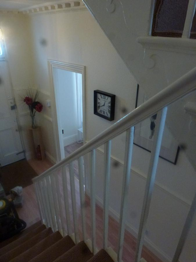 Curved staircase leading to sitting room