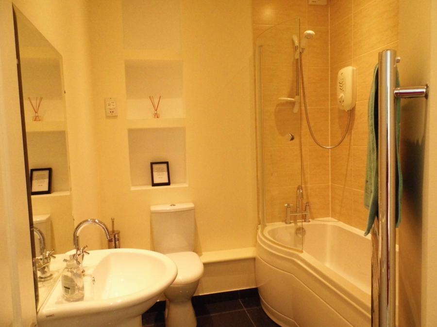 Modern bathroom with bath and shower & heated towel rail