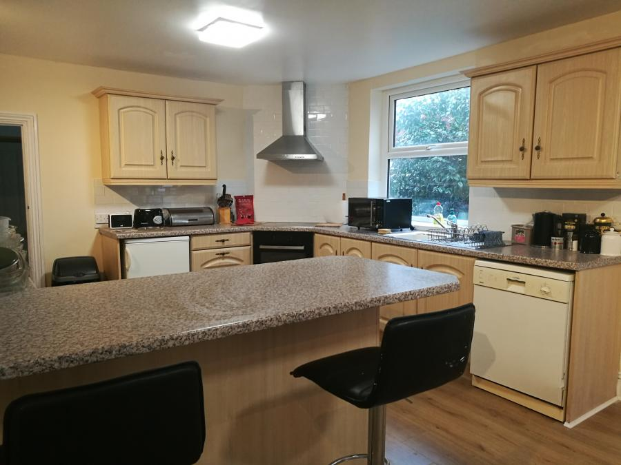 Spacious kitchen with breakfast bar and dining area